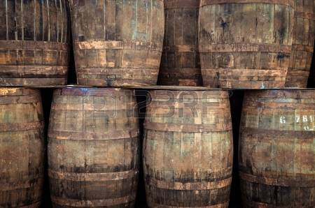24050478-stacked-pile-of-old-whisky-barrels.jpg